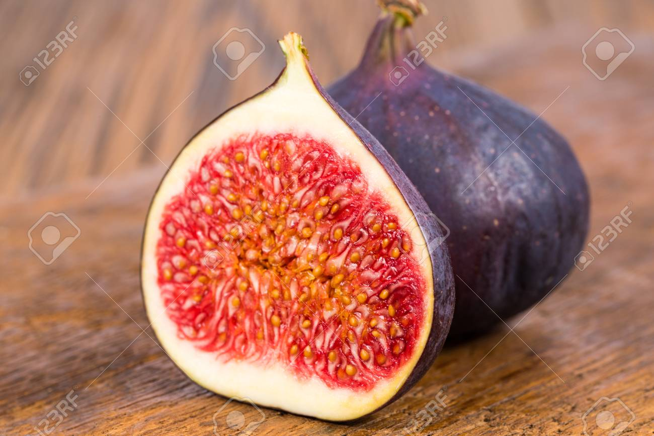One Whole And On Half Sliced Ripe Delicious And Sweets Figs