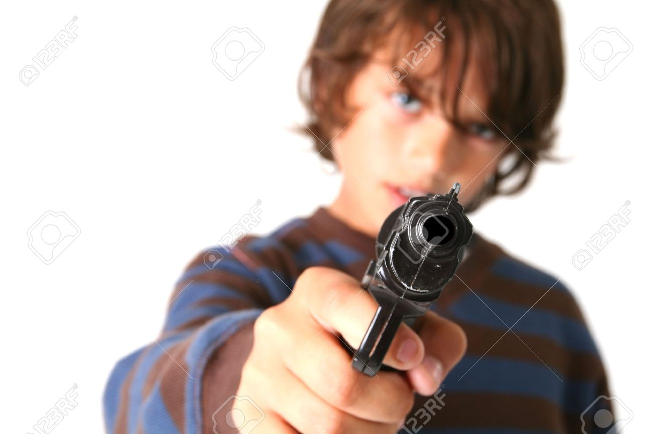 child with gun isolated on white. kid playing gangster or criminal Stock Photo - 5782019