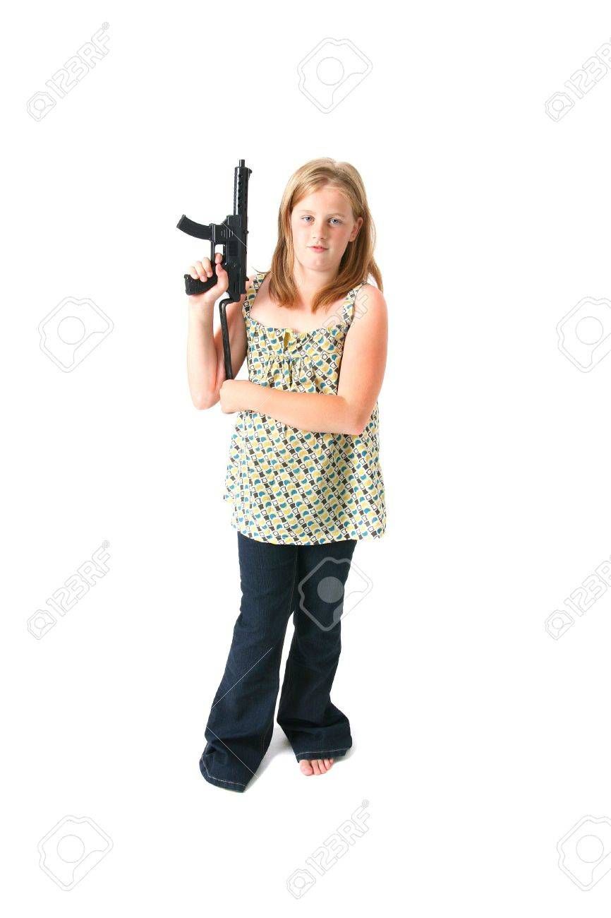 girl with gun isolated on white. child or teenager in dress with army machine gun toy Stock Photo - 5781965