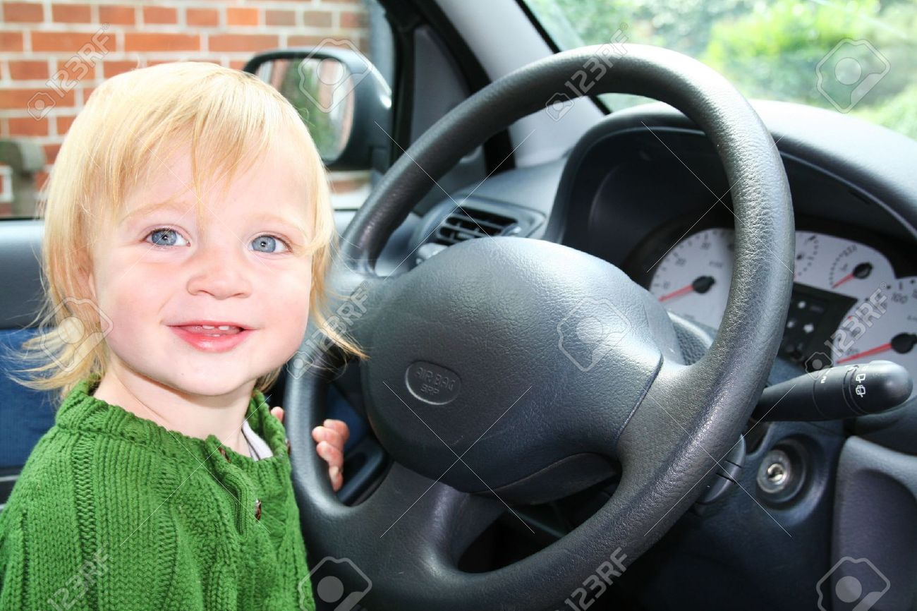 Child Driving Car Toddler Boy In Vehicle Holding Steering Wheel Pretend To Drive Stock Photo
