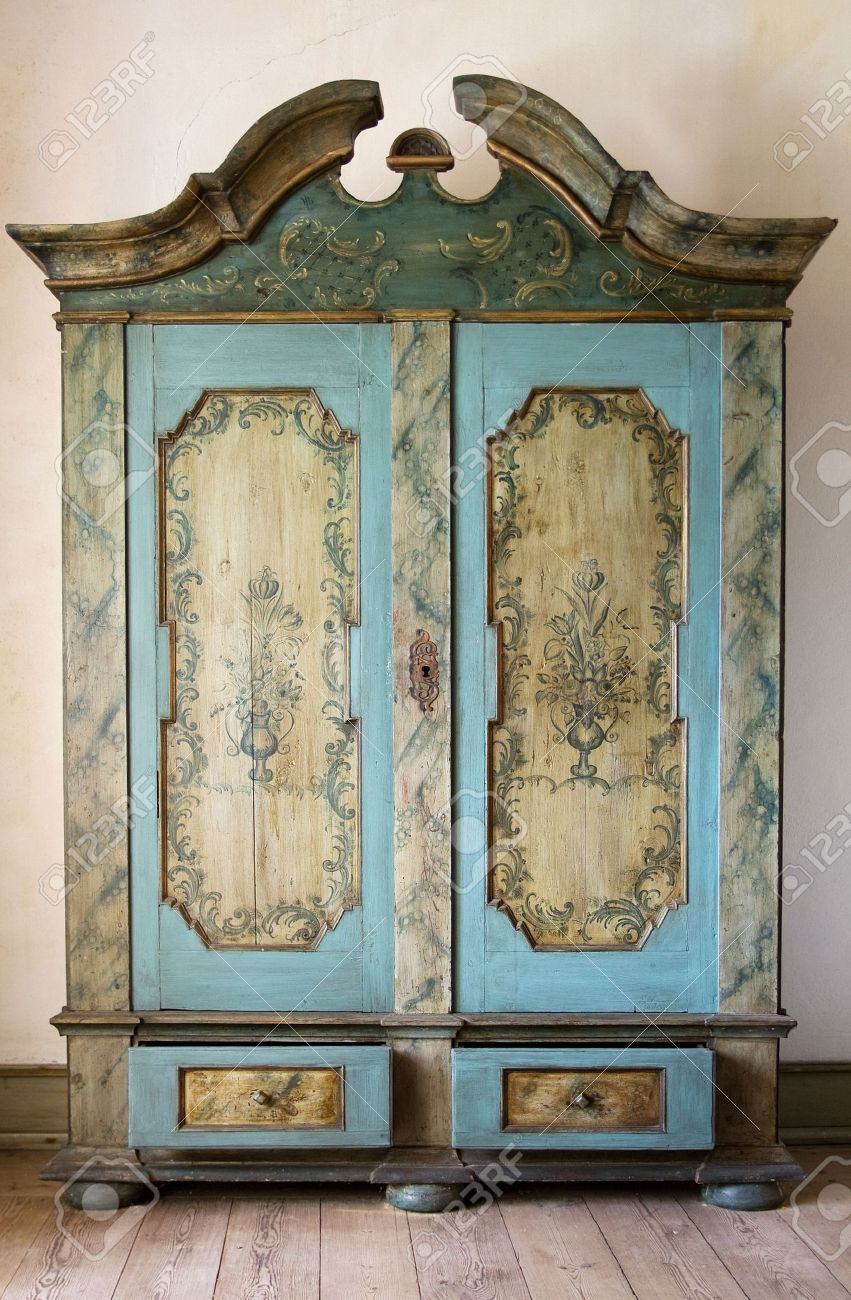 antique painted cupboard old hand made furniture in wood with drawers and doors stock photo - Antique Cupboard