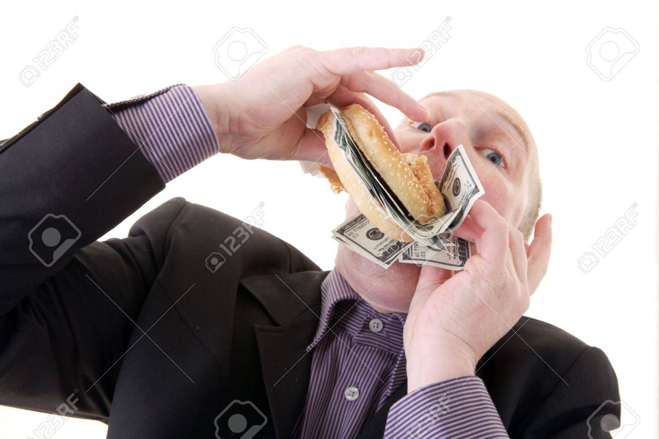 greed, businessman eating money. man eat dollars in display of avarice isolated on white. - 6095925