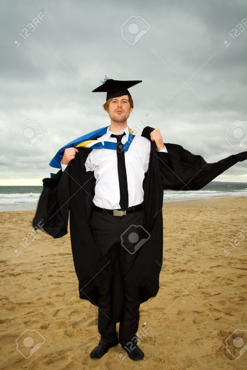 Student Graduating With Cap And Gown On Beach. University Graduate ...