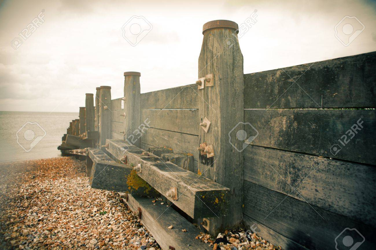 groyne or sea defense for breaking waves. seaside beach with wood constructions and water on misty day Stock Photo - 16240649