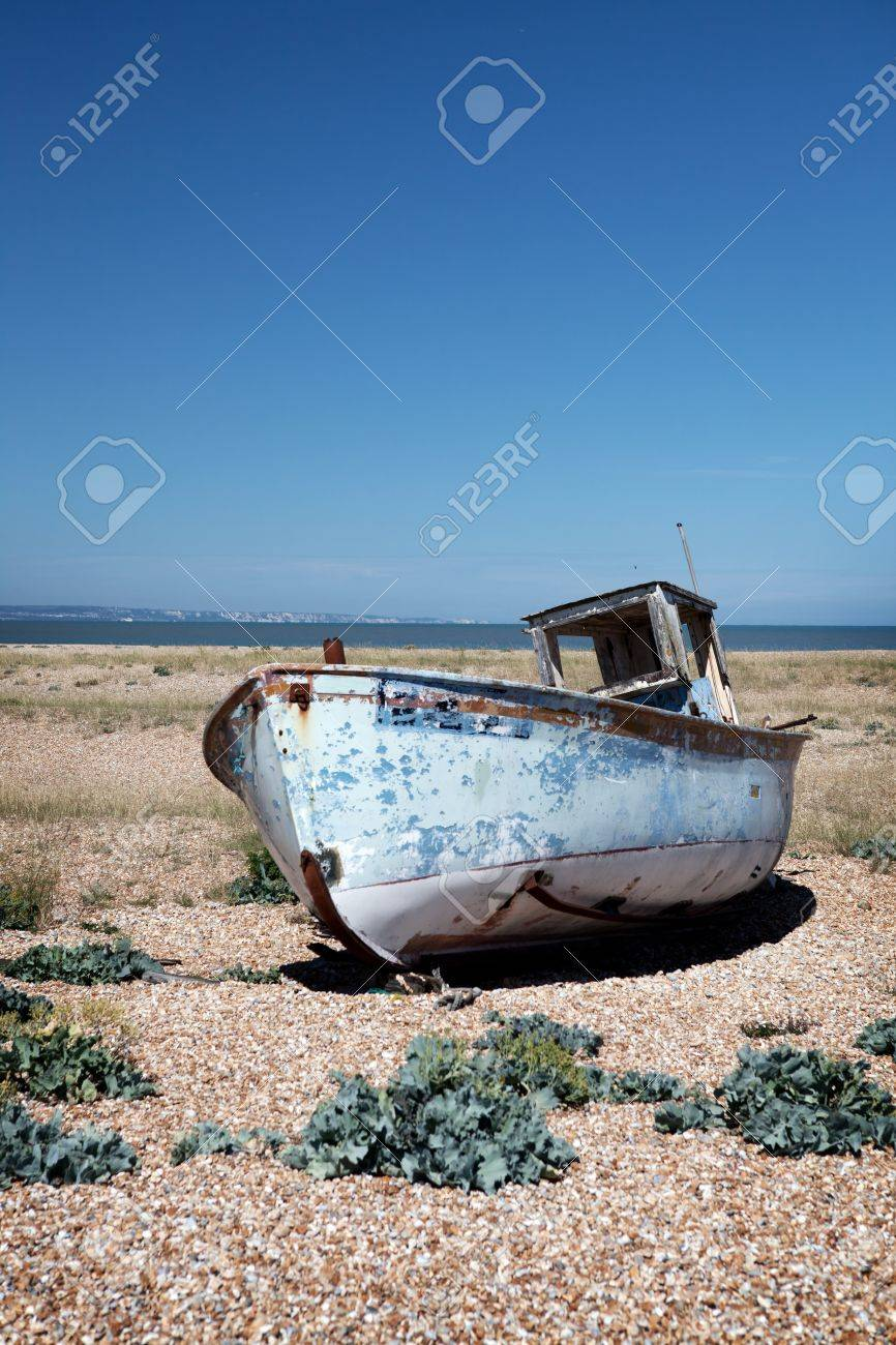 abandoned fishing trawler on beach. old ship wreck on english south coast in dungeness Stock Photo - 16240676
