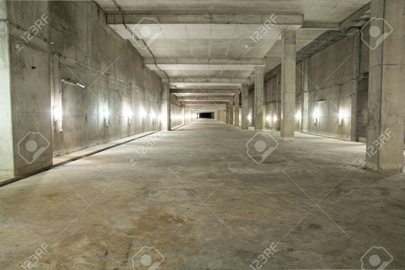 Empty Industrial Garage Room Interior With Concrete Floor And Wall Background Stock Photo