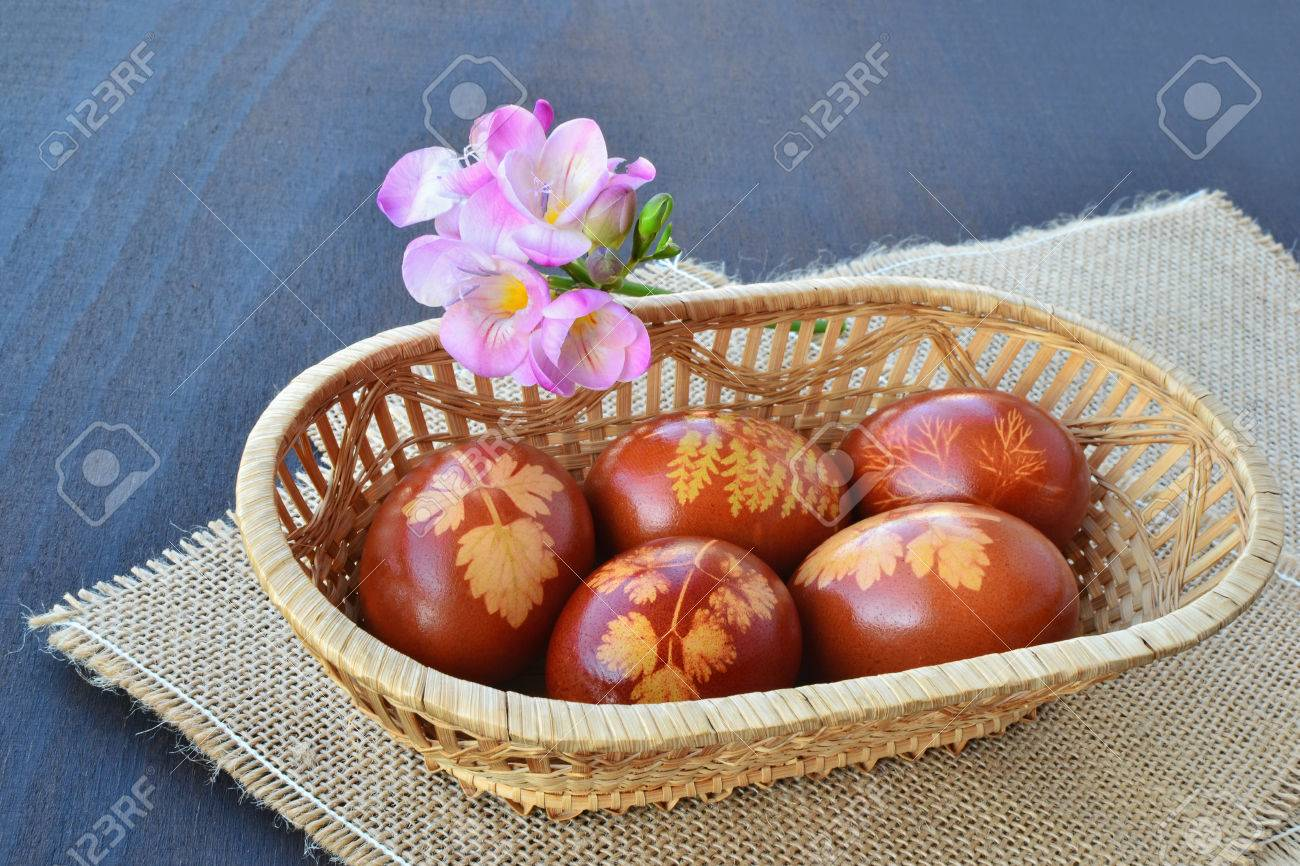 beautiful easter eggs dyed with onion skin in small basket stock