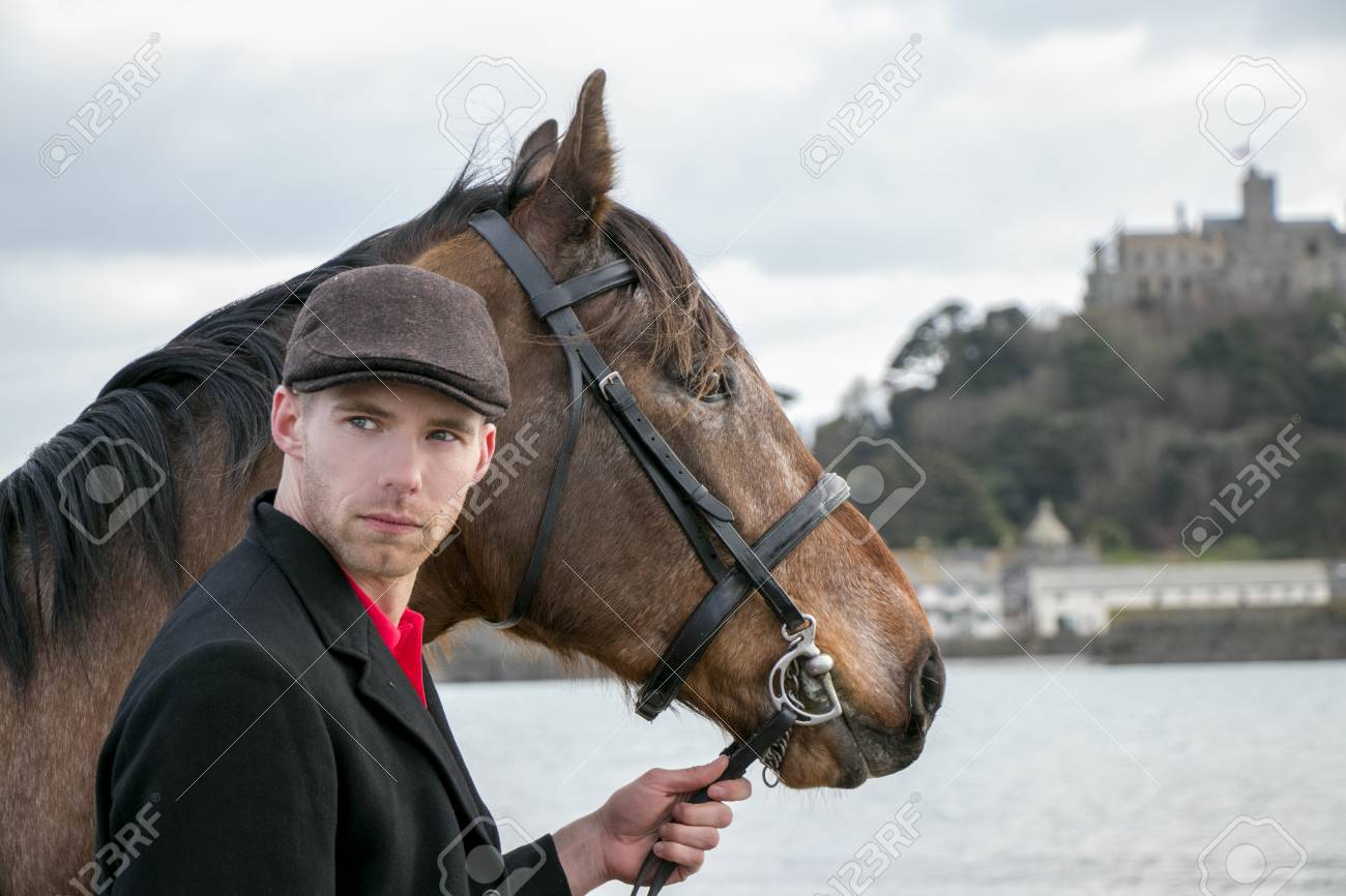 Horse Rider In Traditional Riding Gear On Beach In Front Of St Stock Photo Picture And Royalty Free Image Image 99350113