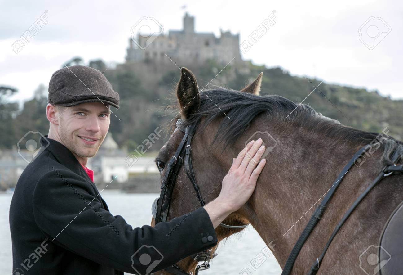 Horse Rider In Traditional Riding Gear On Beach In Front Of St Stock Photo Picture And Royalty Free Image Image 99135162