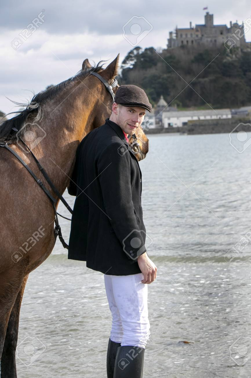 Horse Rider In Traditional Riding Gear On Beach In Front Of St Stock Photo Picture And Royalty Free Image Image 99135164