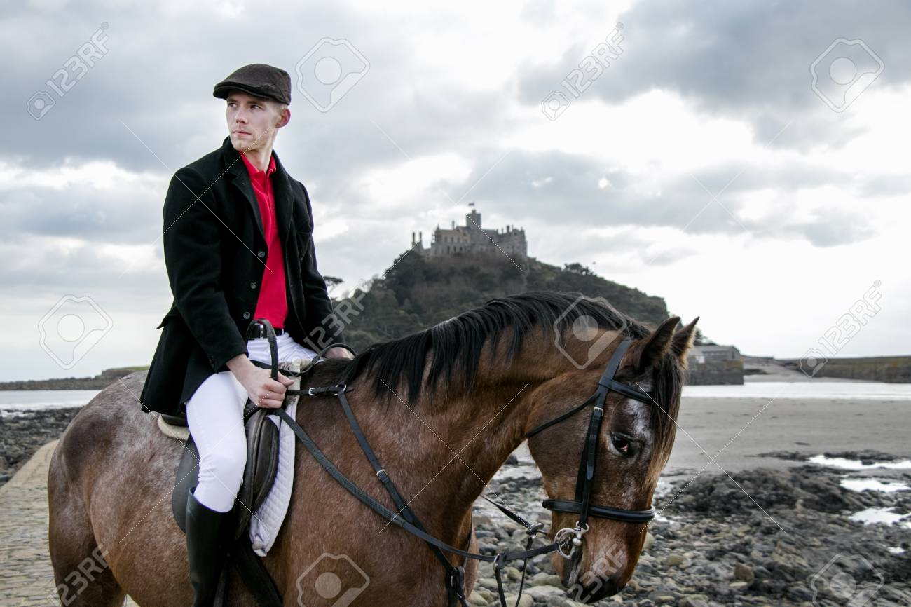 Horse Rider Sits On Horseback In Traditional Riding Gear On Beach Stock Photo Picture And Royalty Free Image Image 99135174