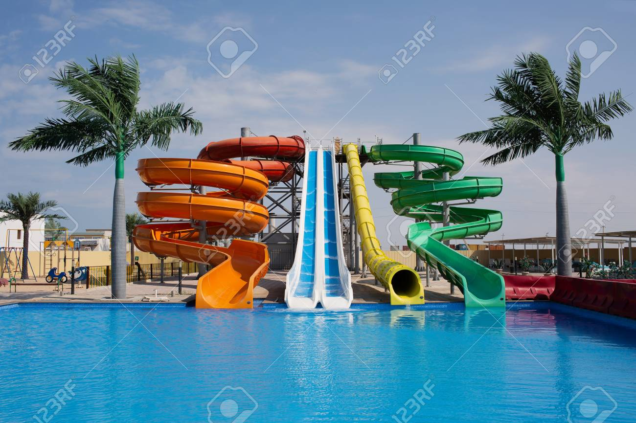 Multicoloured big water slide in the public swimming pool