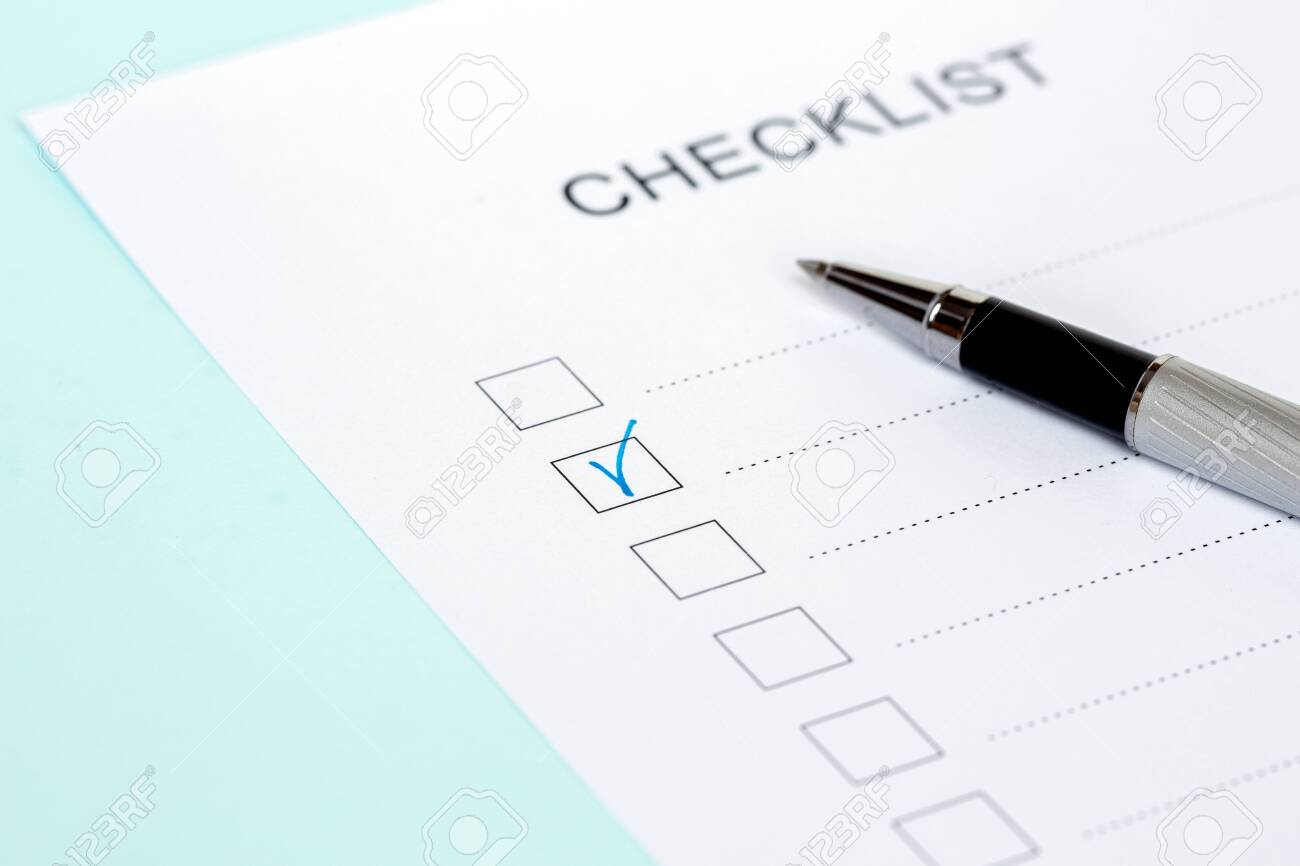 Close-up of on Checklist with pen on a blue background. - 145429478