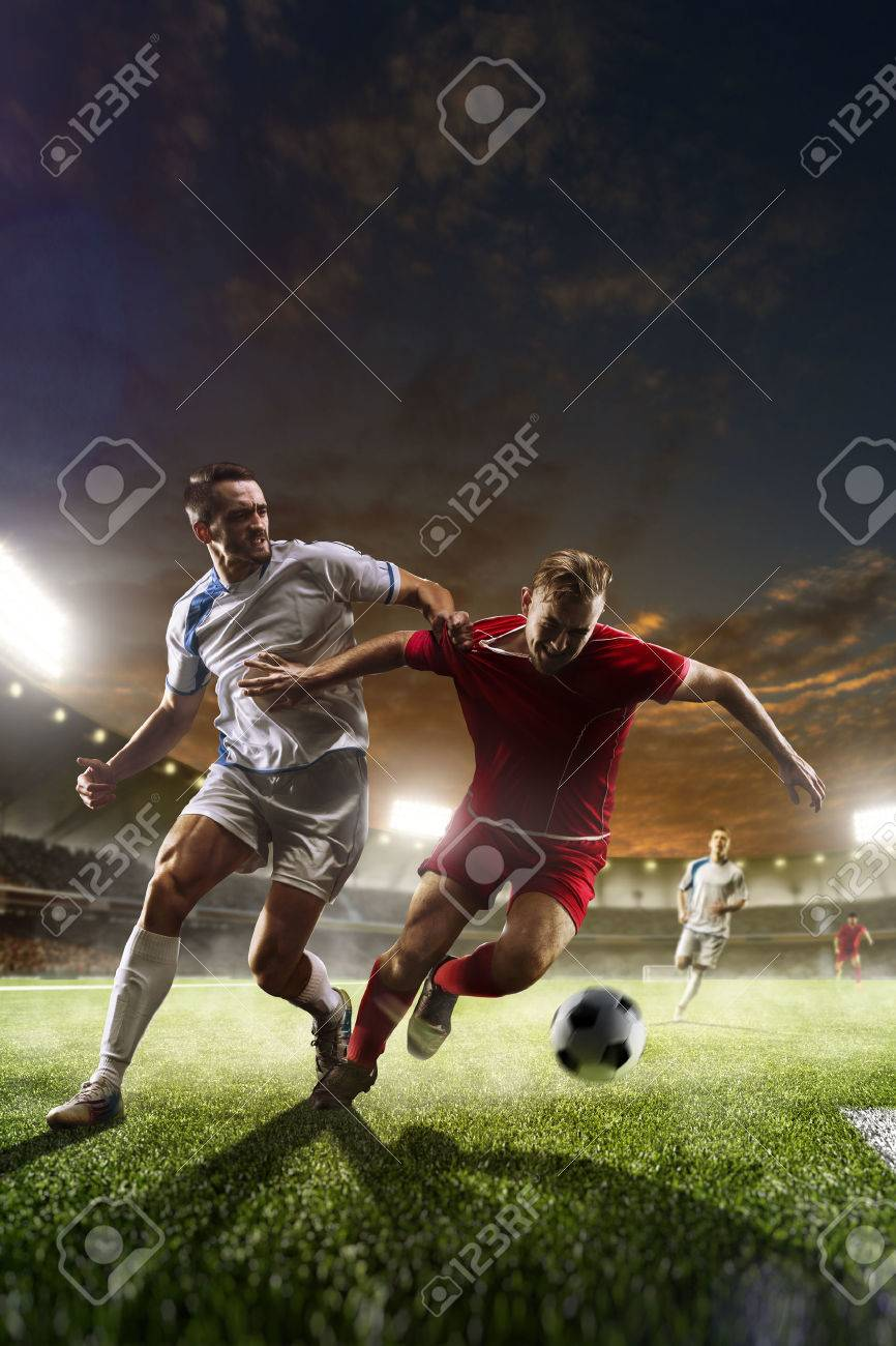 Soccer players in action on sunset stadium background panorama - 50565187