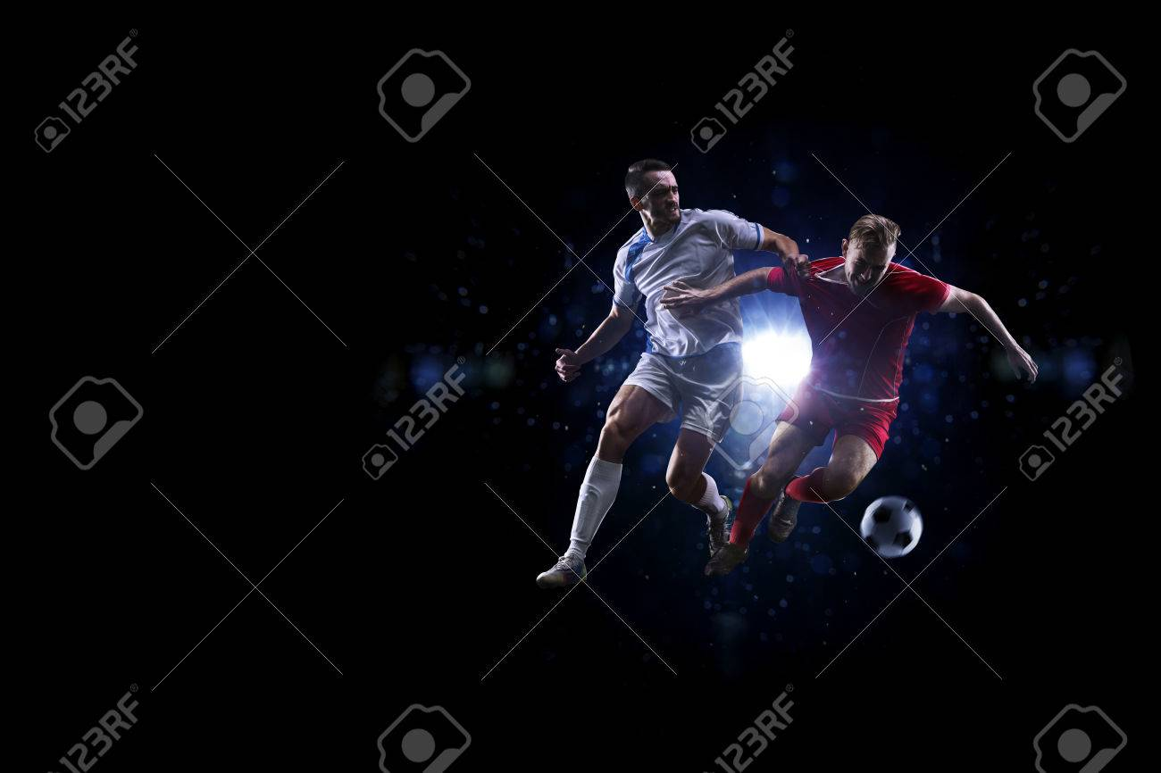 Soccer players in action over black background - 50612720