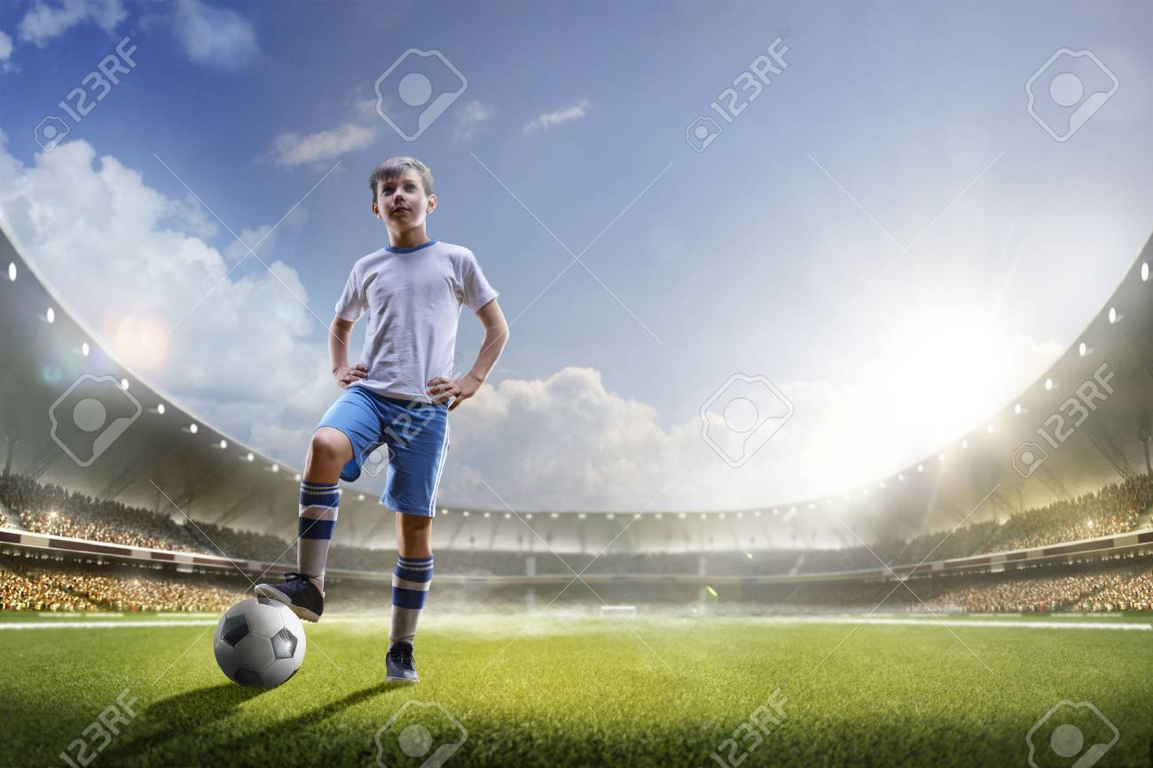 Childrens are playing soccer on grand arena in sunlights - 57366077