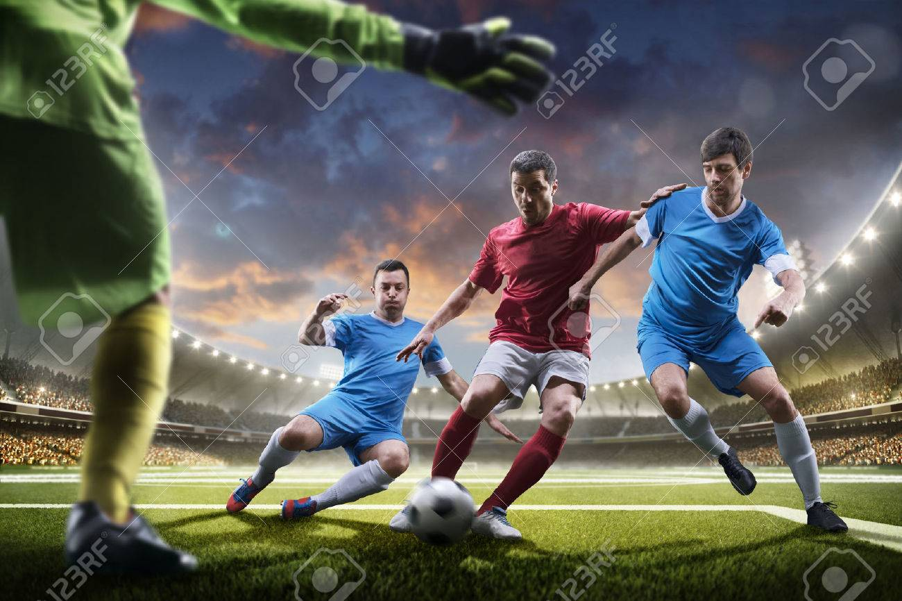 Soccer players in action on the sunset stadium background panorama - 57836249
