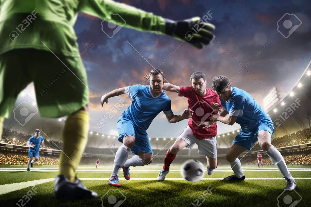Soccer players in action on the sunset stadium background panorama - 57836244
