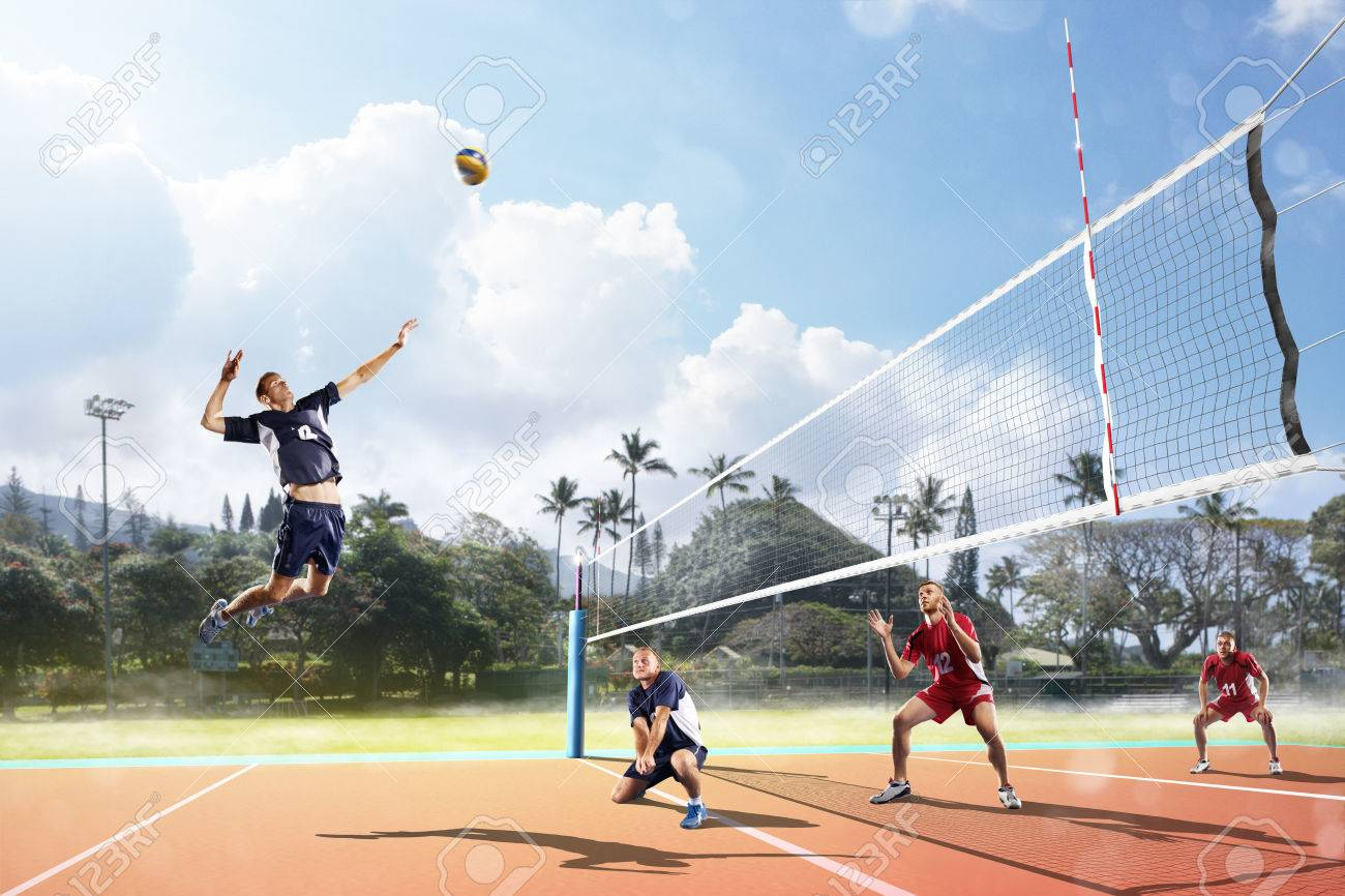 Professional volleyball players in action on the open air court - 62481647
