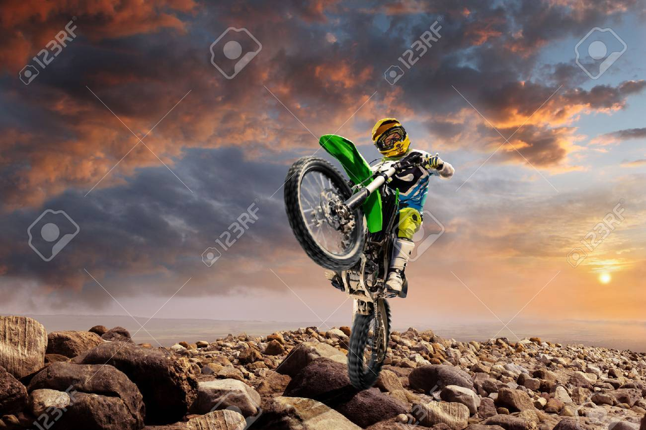 Professional dirt bike rider doing wheely on the top of vulcan - 69711397