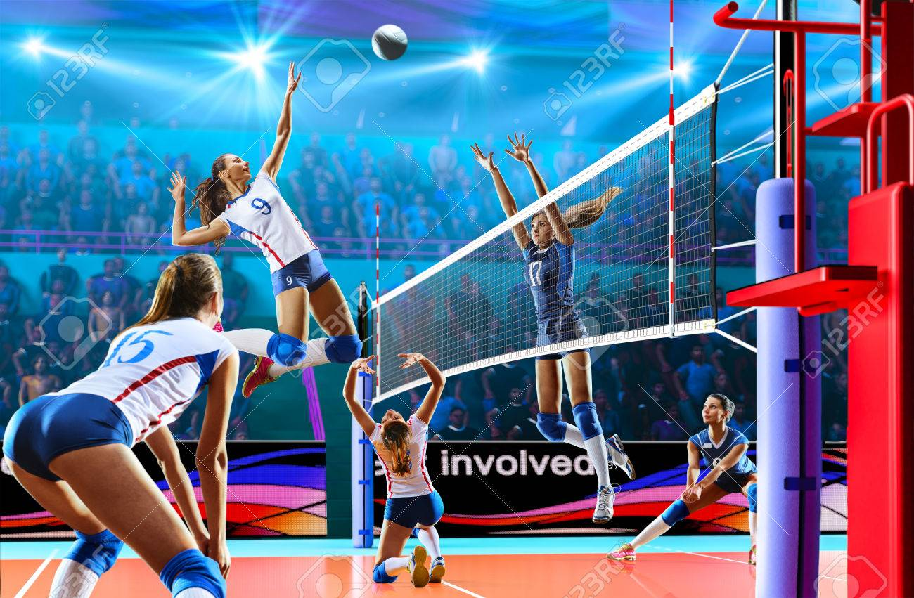 Female professional volleyball players in action on grand court - 82914491