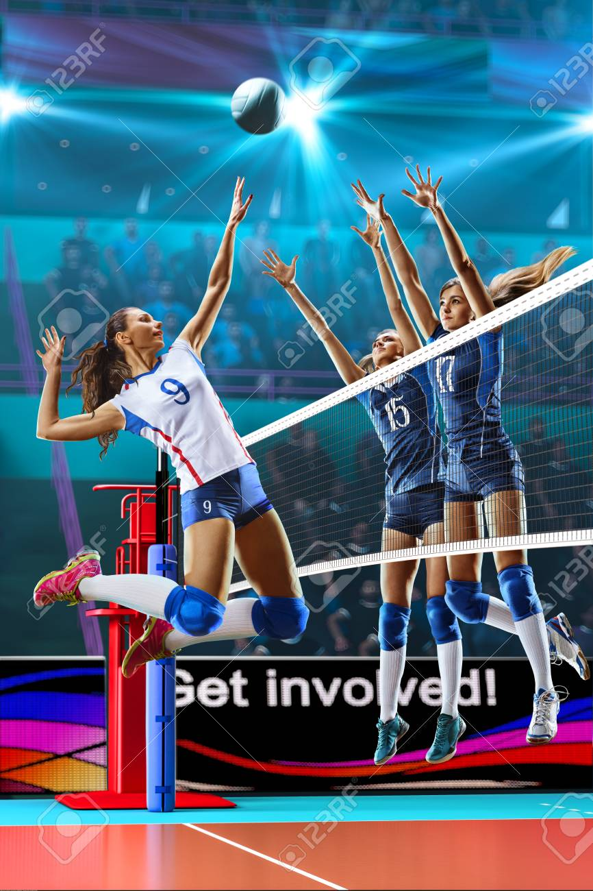 Female professional volleyball players in action on grand court - 82856513