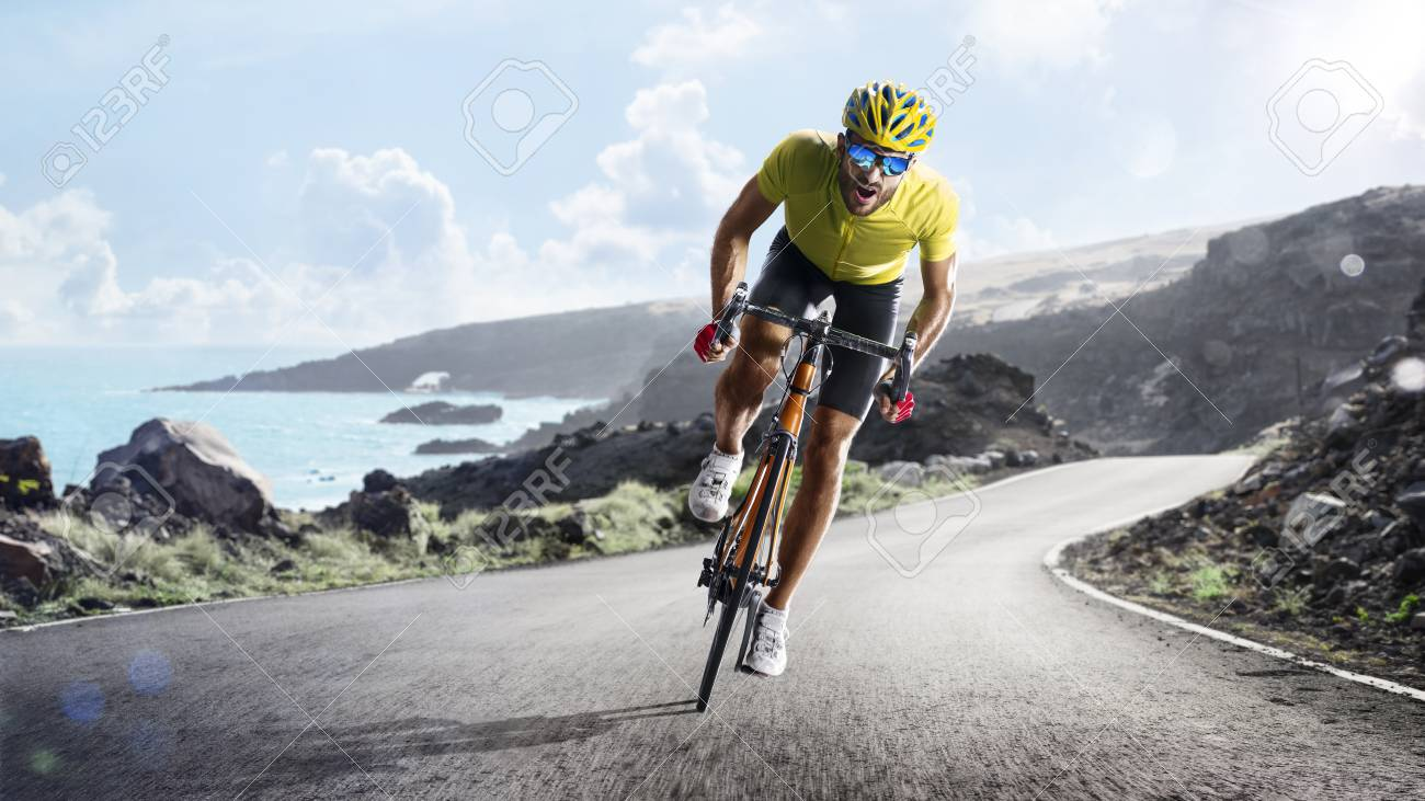 Professional road bicycle racer in action - 99118349