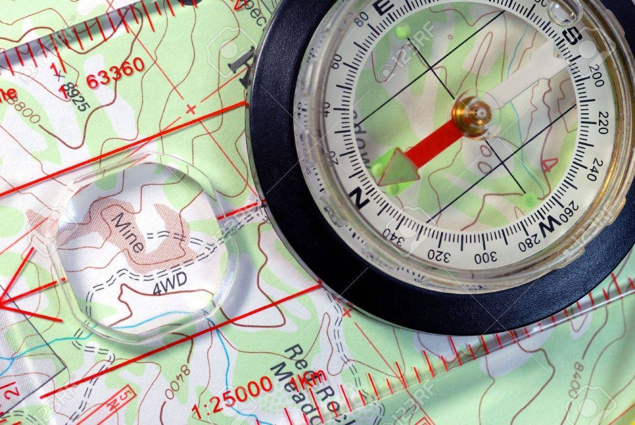 Transparent Navigational Compass on Topographical Map, Needle Pointing to Magnetic North Stock Photo - 3482066
