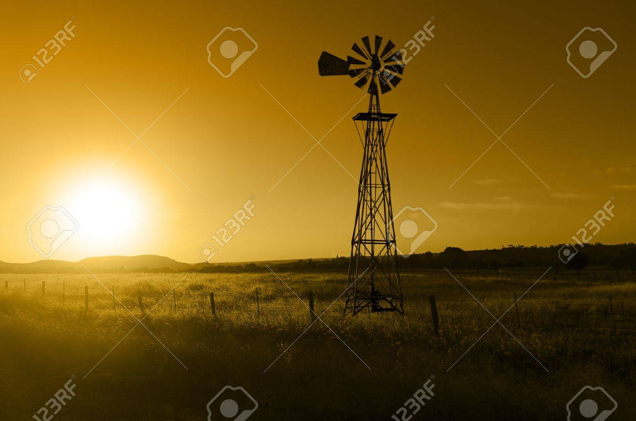 Traditional, old fashioned water pumping ranch windmill, rangeland, fencing. Stock Photo - 16183434