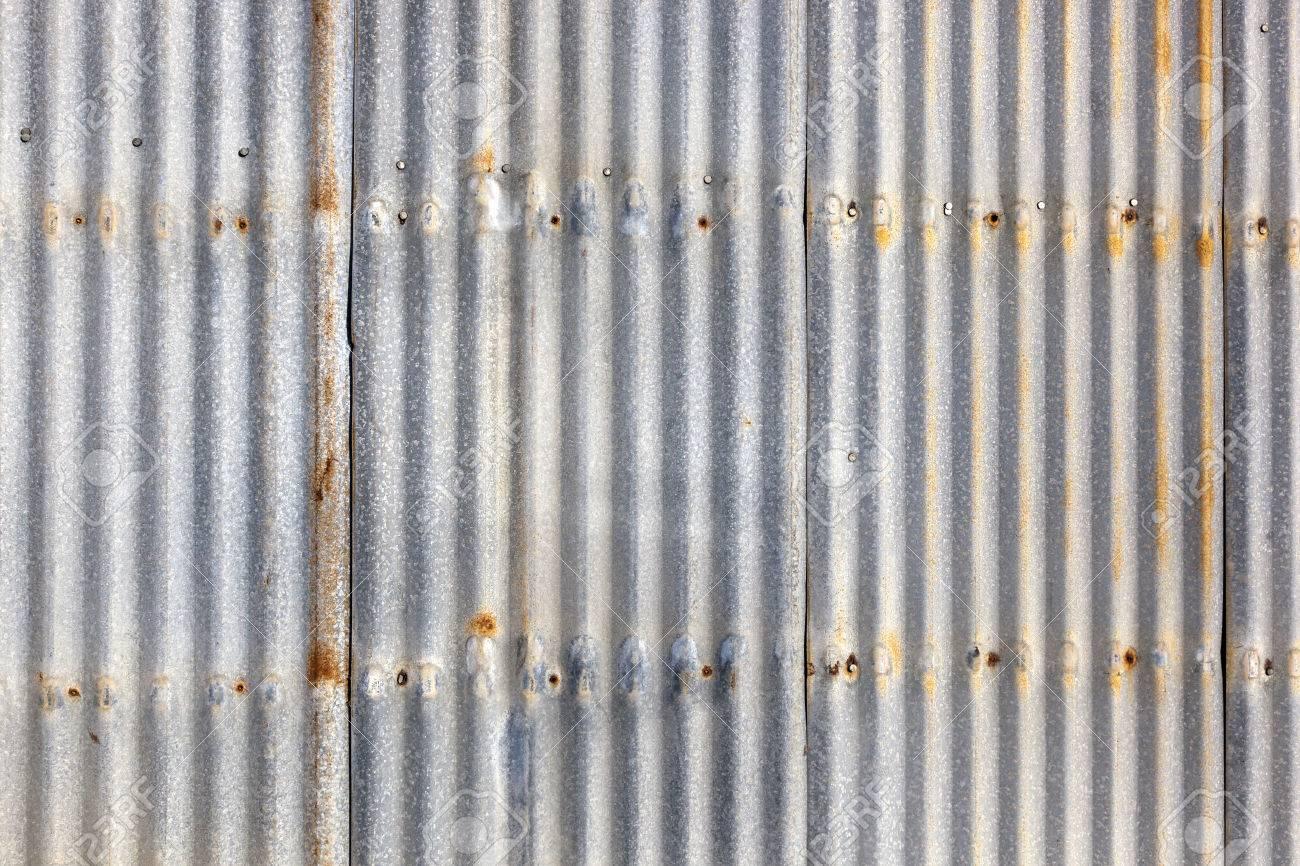 Rusted, galvanized, corrugated iron siding, vintage background Stock Photo - 23043931