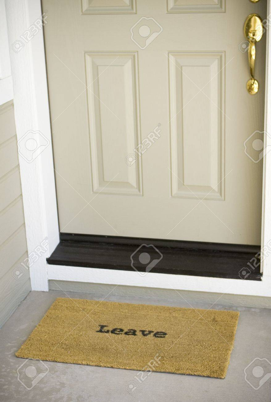 A mat in front of a door that simply states, Stock Photo - 3546362