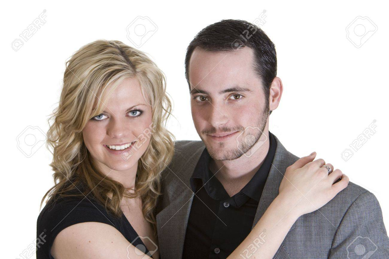 Couple with arms around each other smiling at the camera, isolated on white background. Stock Photo - 4369769