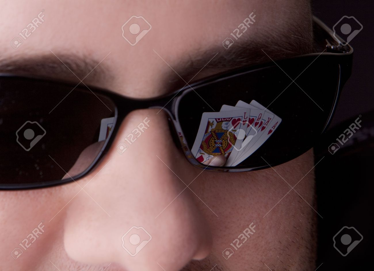 Close-up of man's glasses with a royal flush reflected in them. Stock Photo - 6013966