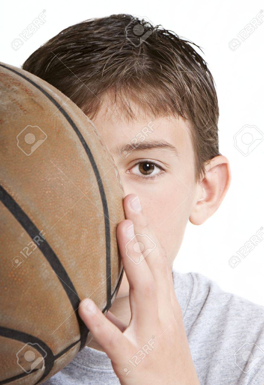 Youth with basketball partially hidden behind face. Stock Photo - 7241059