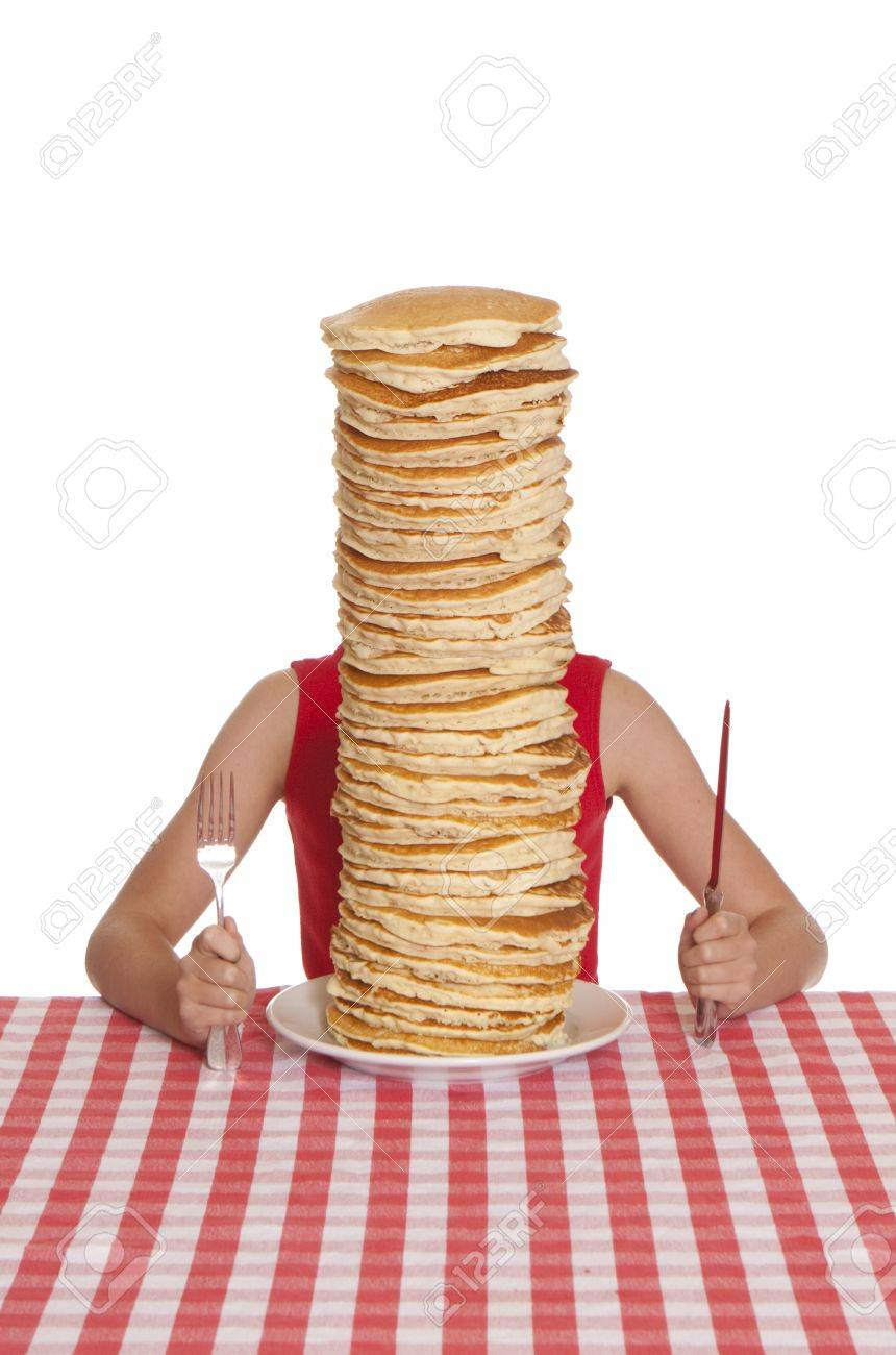 Little girl with a giant plate of pancakes, a knife and fork on a table cloth. Stock Photo - 11281166