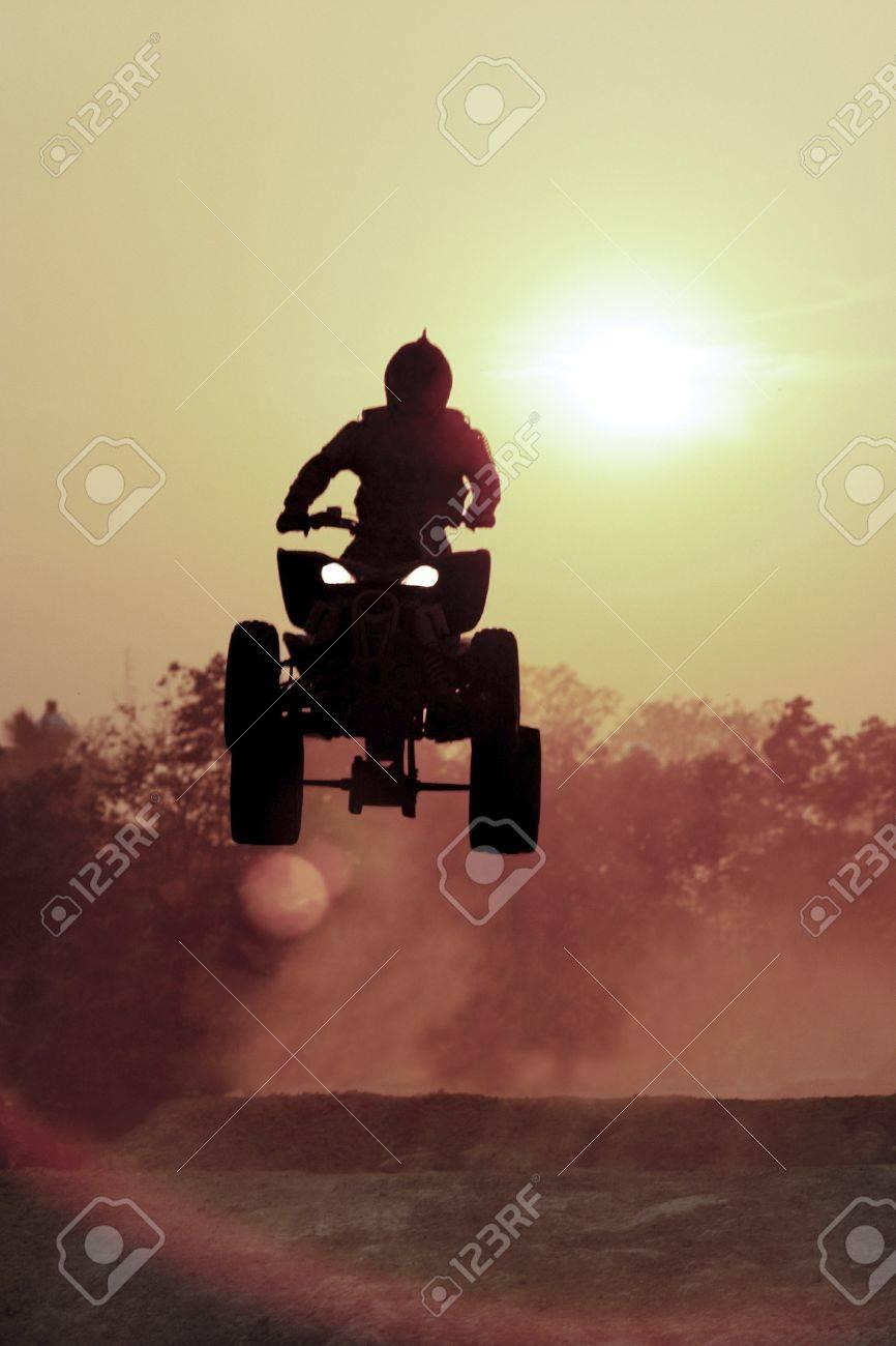 Silhouette ATV jump on dirt track Stock Photo - 16459682