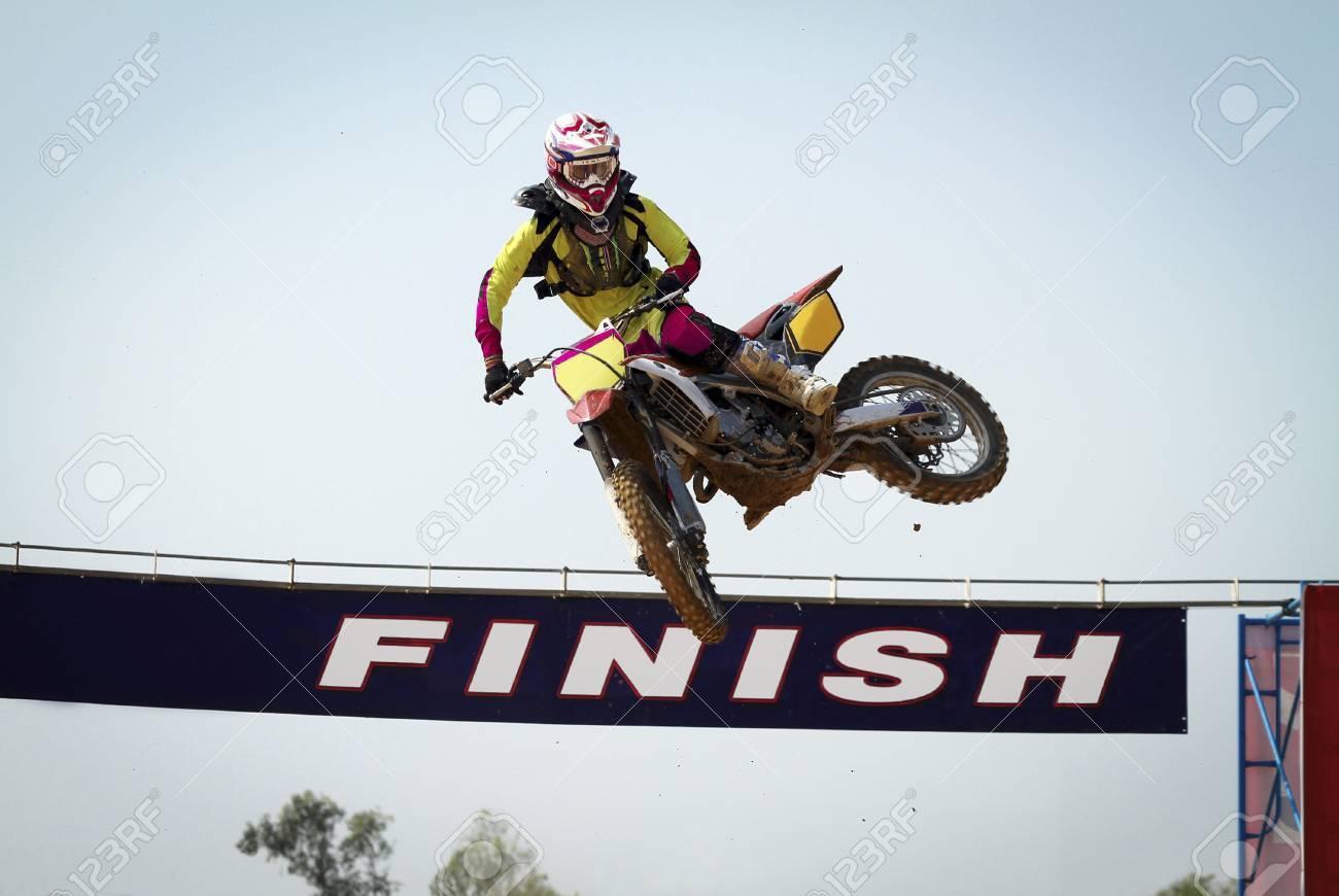 Red Motocross winner jump  Stock Photo - 17511109