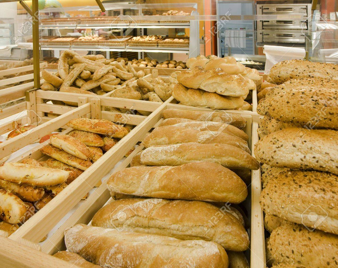 Loaves of bread on shelves in a store Stock Photo - 4280425