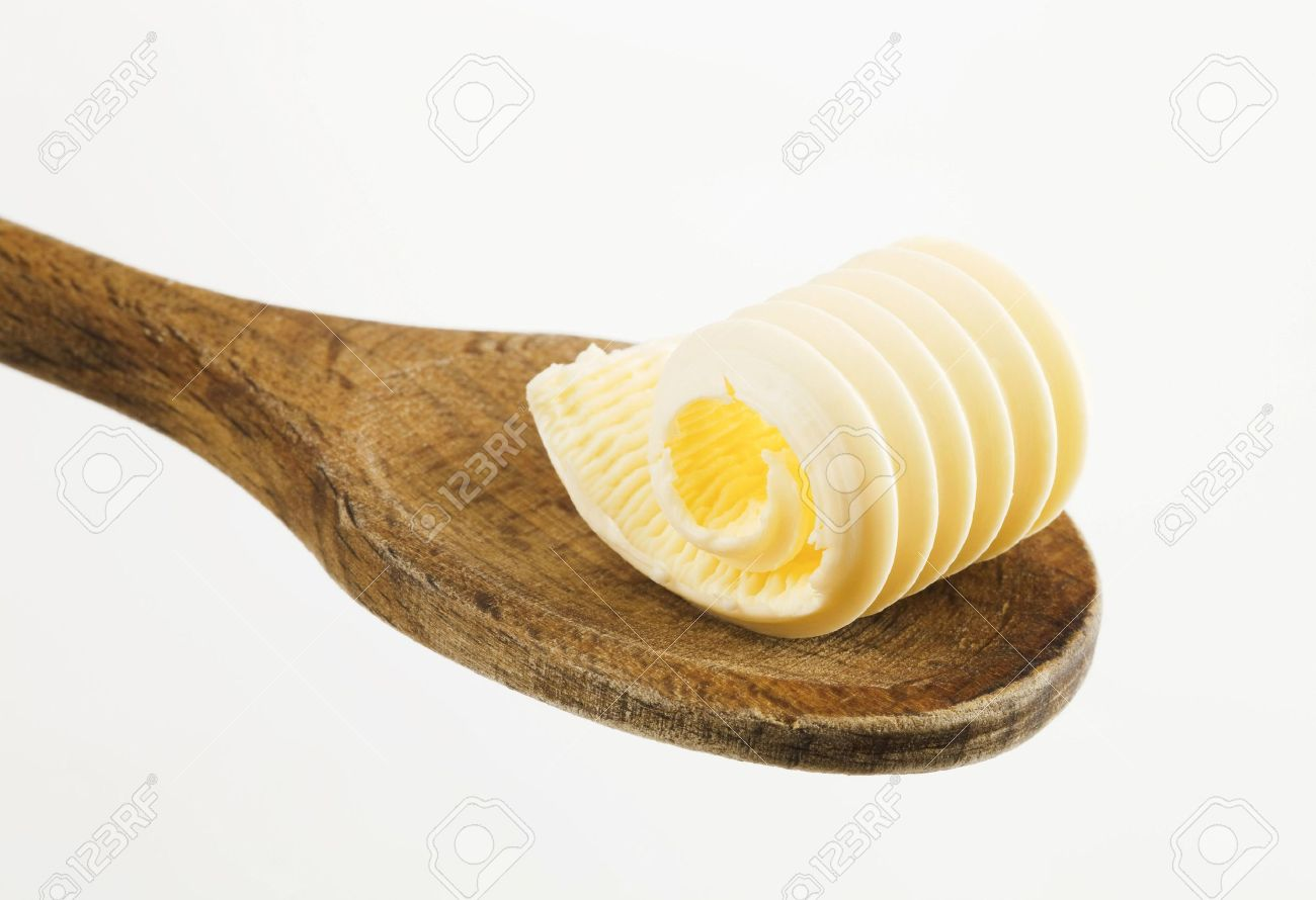 Single butter curl on a wooden spoon Stock Photo - 5030627
