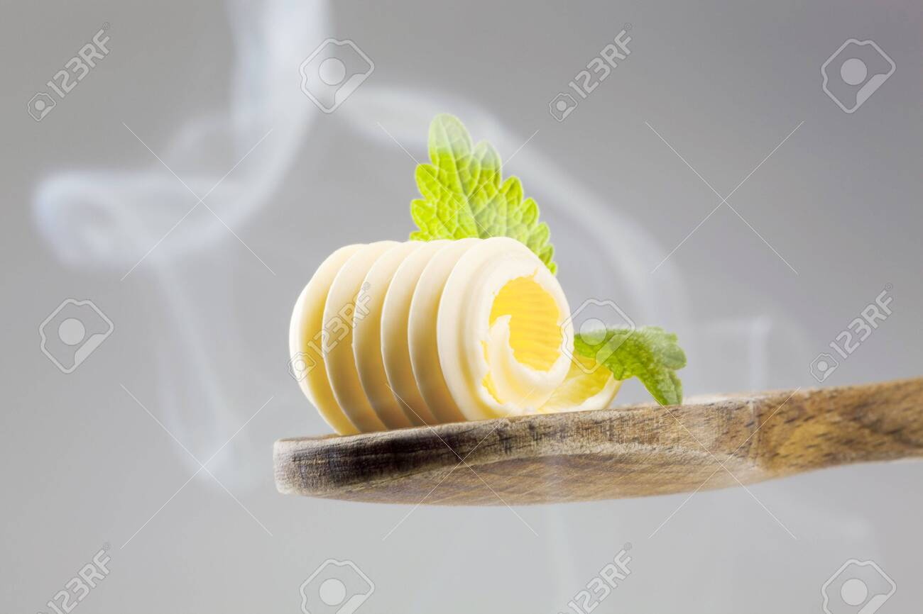 Butter curl on a wooden spoon in steam Stock Photo - 5268917