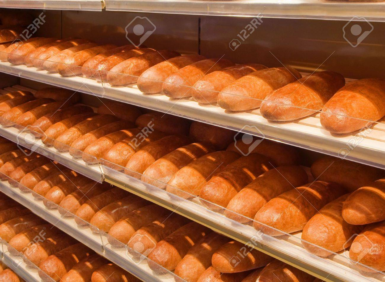 Loaves of bread on shelves in a store Stock Photo - 5434645