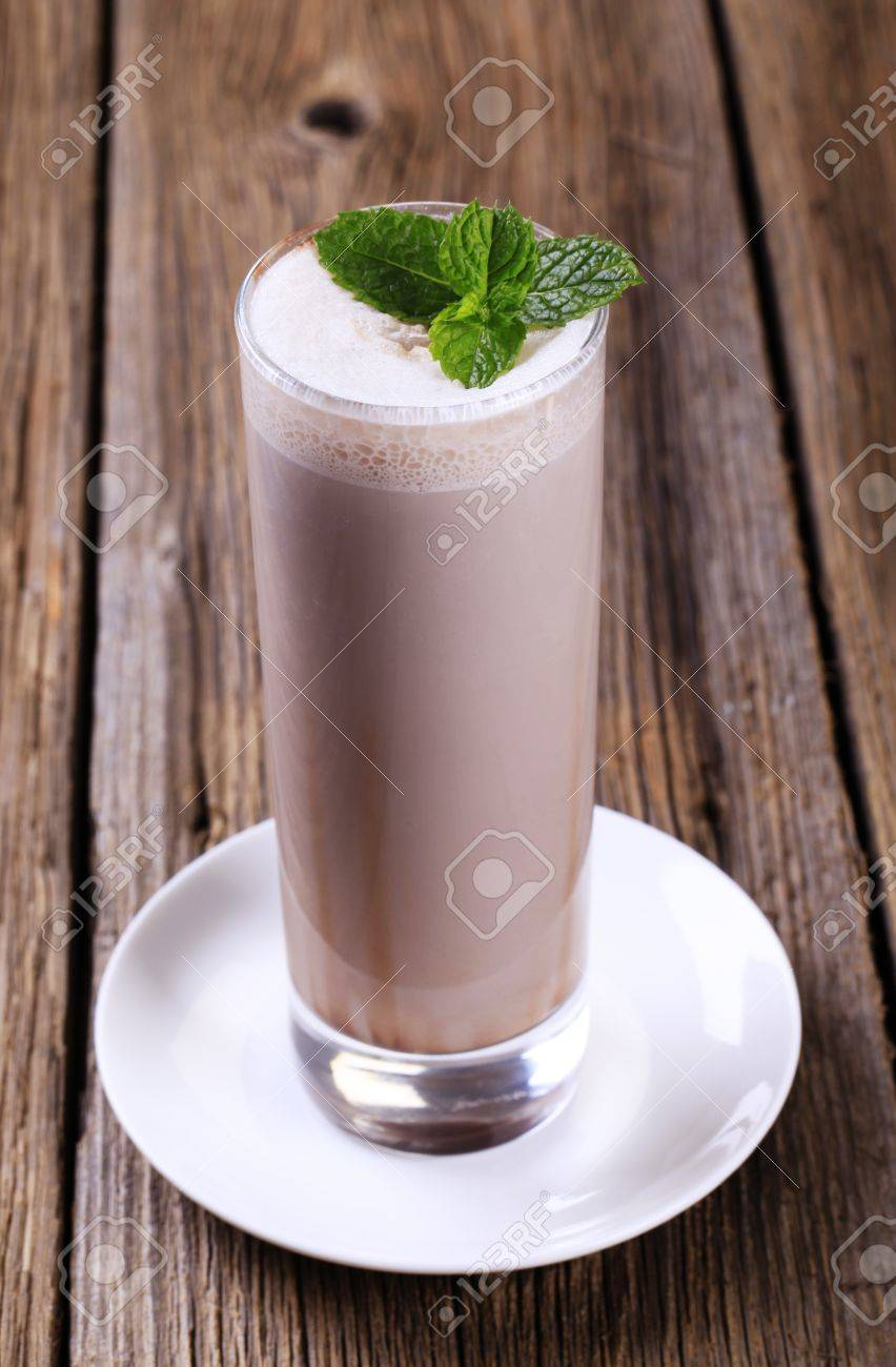 Glass of chocolate milk shake on wooden table Stock Photo - 8557428