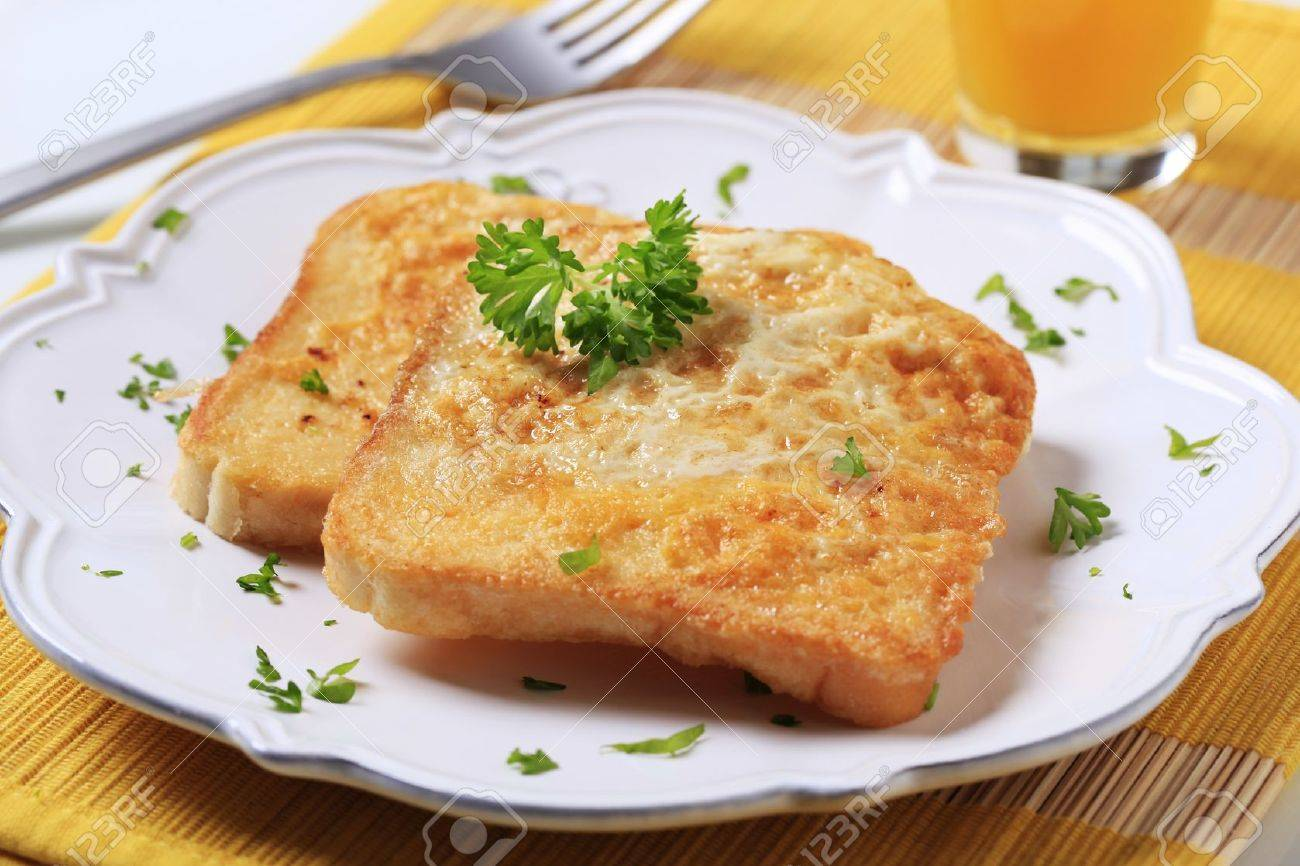 Two slices of French toast on a plate Stock Photo - 8696240