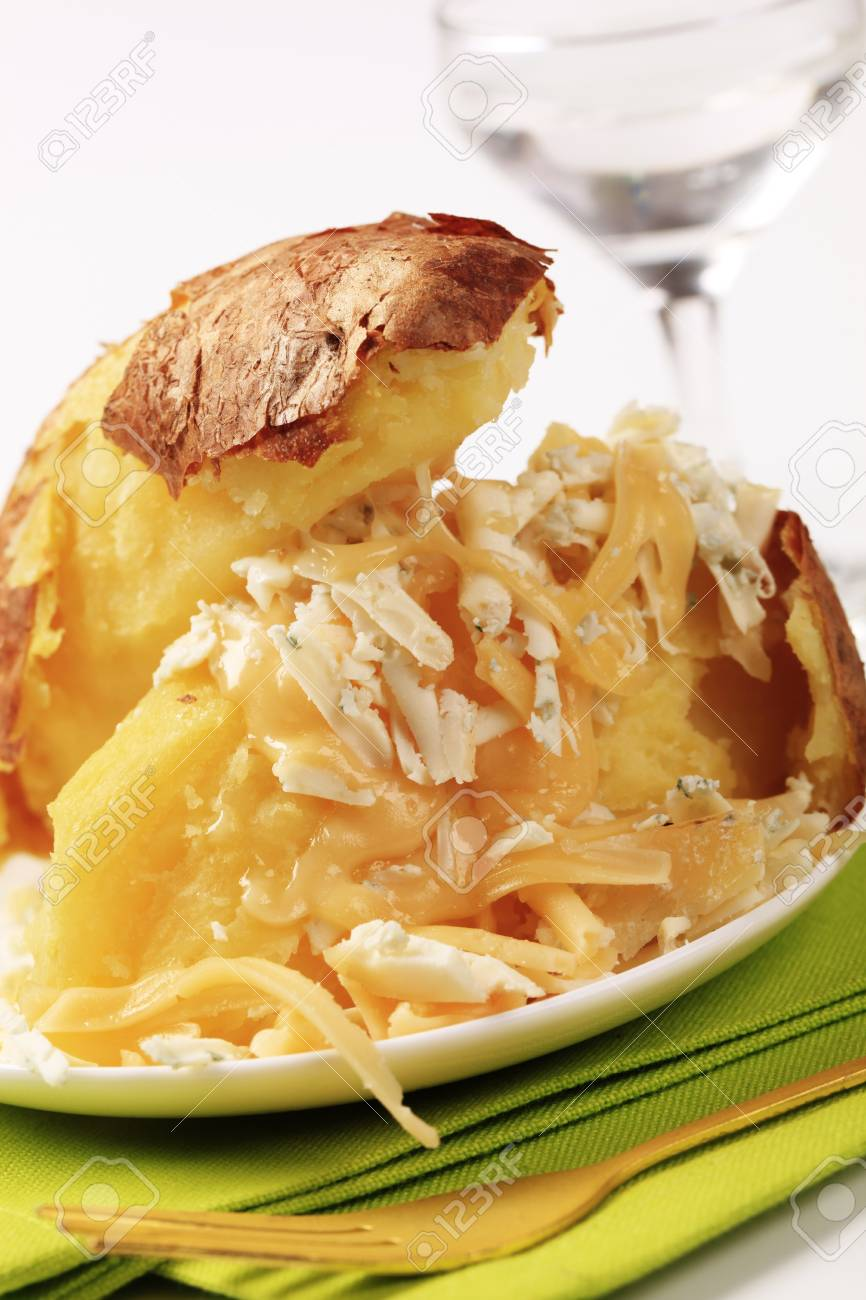 Baked potato sprinkled with two kinds of cheese Stock Photo - 8993389