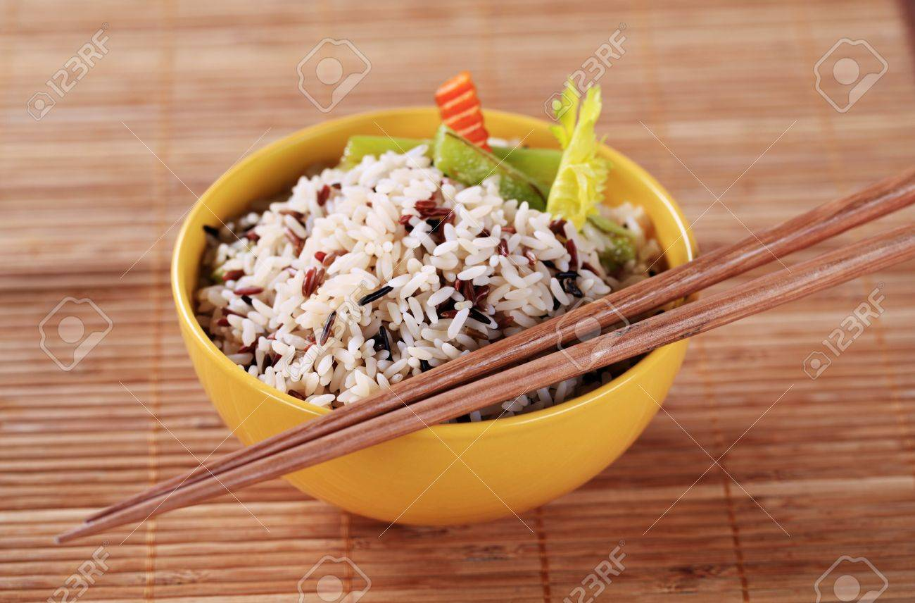 Bowl of cooked mixed rice - detail Stock Photo - 9079424