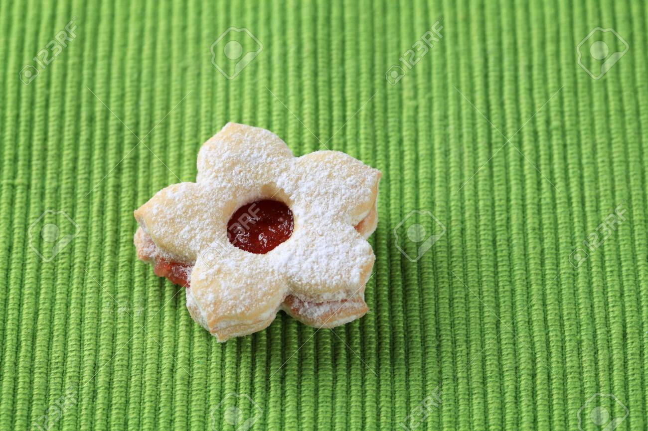 Jam filled cookie on a green napkin Stock Photo - 11127331
