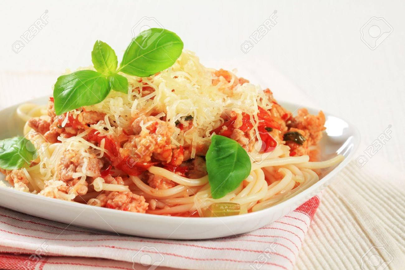 Spaghetti with minced meat and tomato sprinkled with cheese Stock Photo - 13842558