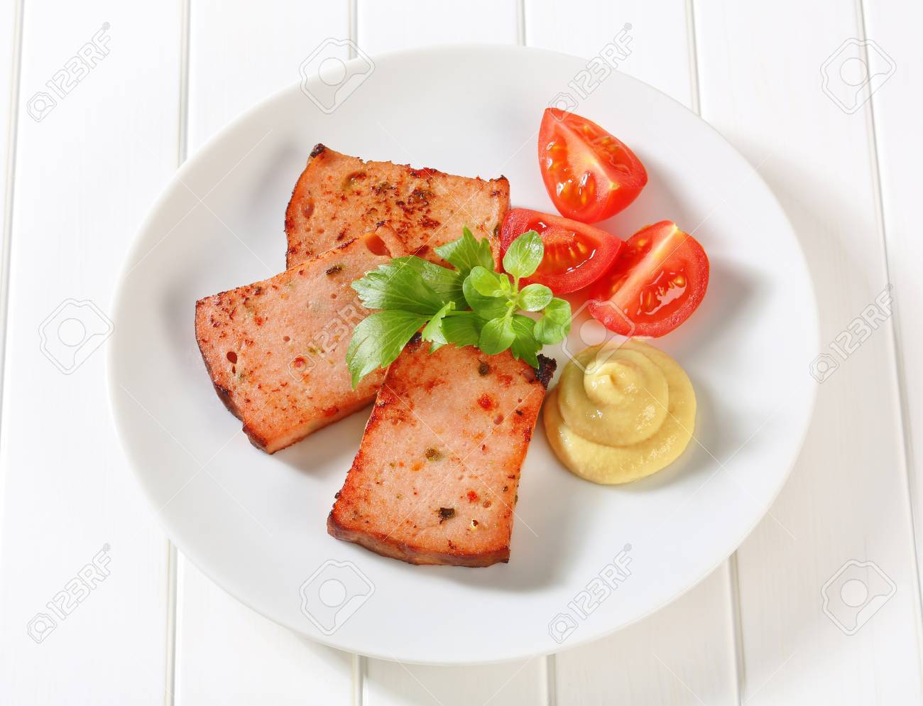 Pan-fried slices of meatloaf with mustard Stock Photo - 20535935