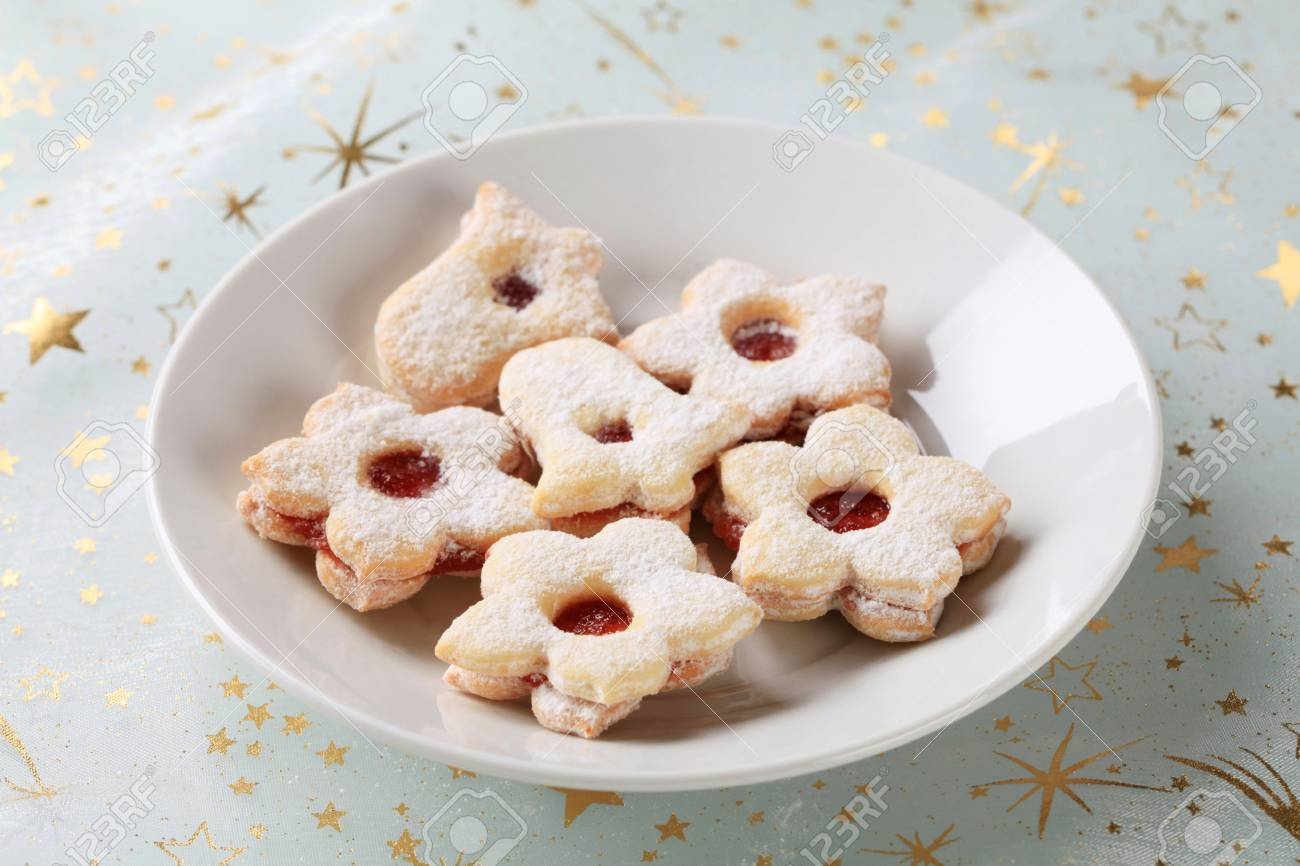 Jam filled cookies sprinkled with icing sugar Stock Photo - 21055361