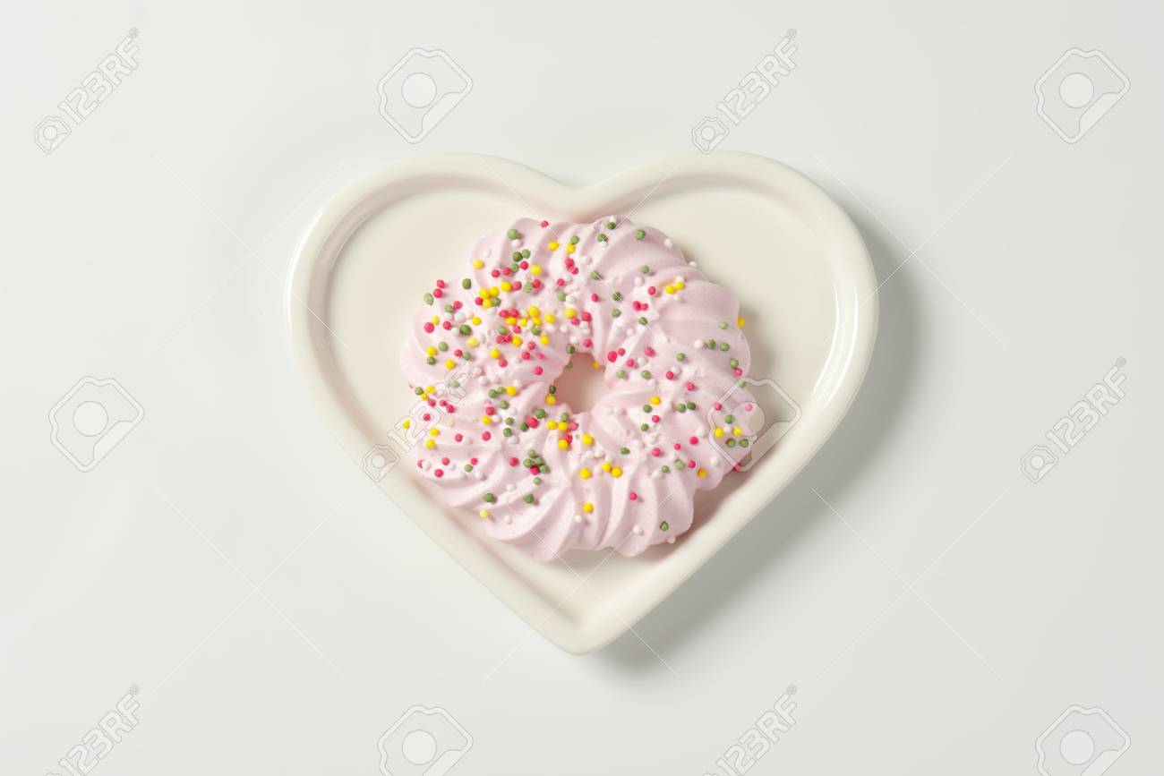 Pink Meringue Wreath Cookie Topped With Sprinkles On Heart Shaped